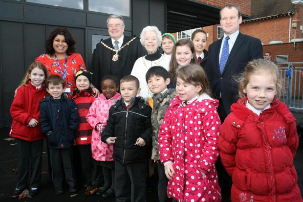 Pupils outside the new building with headteacher Anita Saville, mayor of Merton David Williams, Mayoress Mrs Gill Williams and Councillor Martin Whelton