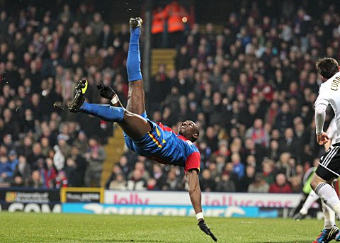 Yannick Bolasie tries a stunning overhead kick which hit the woodwork