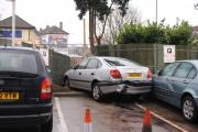 Parking blunder sends daft crashing through fence