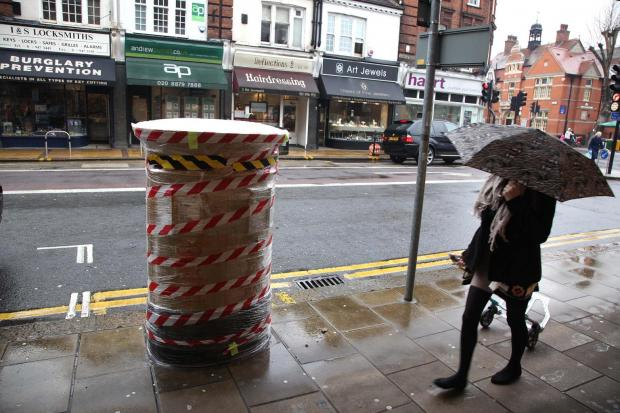Sophie Hosking's gold post box was seen cocooned in plastic today