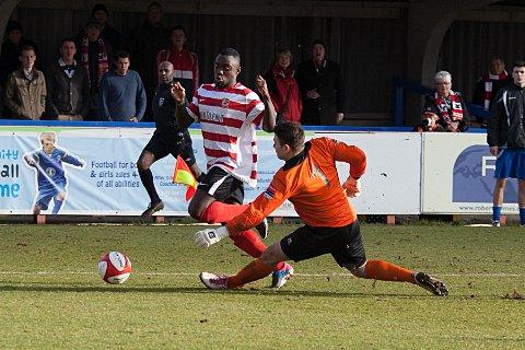 Not this time: Ks Nathan Koranteng tries to round the goalkeeper in the 2-0 defeat to Bury Town    SP72987