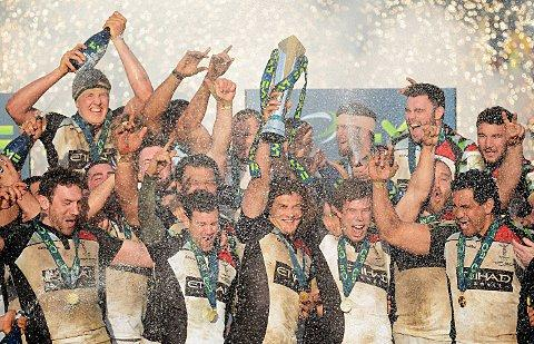 Lovely bubbly: The victorious Quins with the LV= Cup      Picture: Getty Images