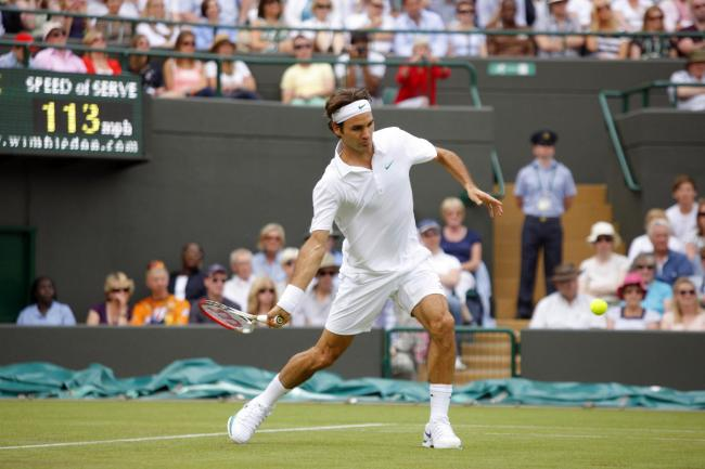 In his way: Former world number one Roger Federer stands between Marcus Willis and a place in the third round at the Wimbledon Championships