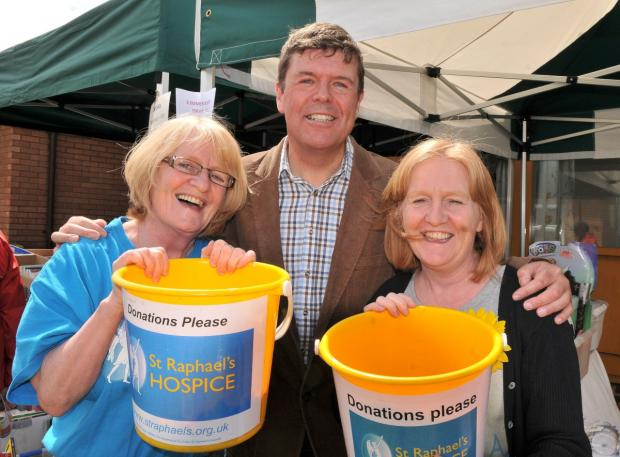 Wimbledon Guardian: Paul Burstow, a long-term supporter of St Raphael's Hospice, celebrating this year's fete with fundraisers