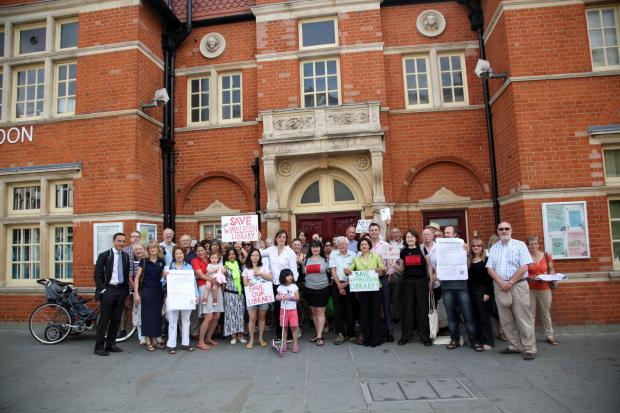 Campaigners protesting the changes outside Wimbledon Library on Monday