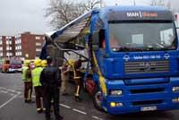 Wimbledon Guardian: Emergency services survey the damage to the lorry Deadlinepix KT12844
