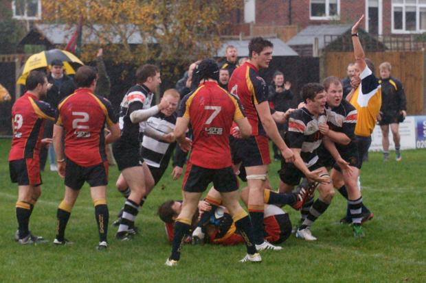 Happier times: Matt Whitaker, second from right, celebrates a try against Chobham – it would be his last match for a long time