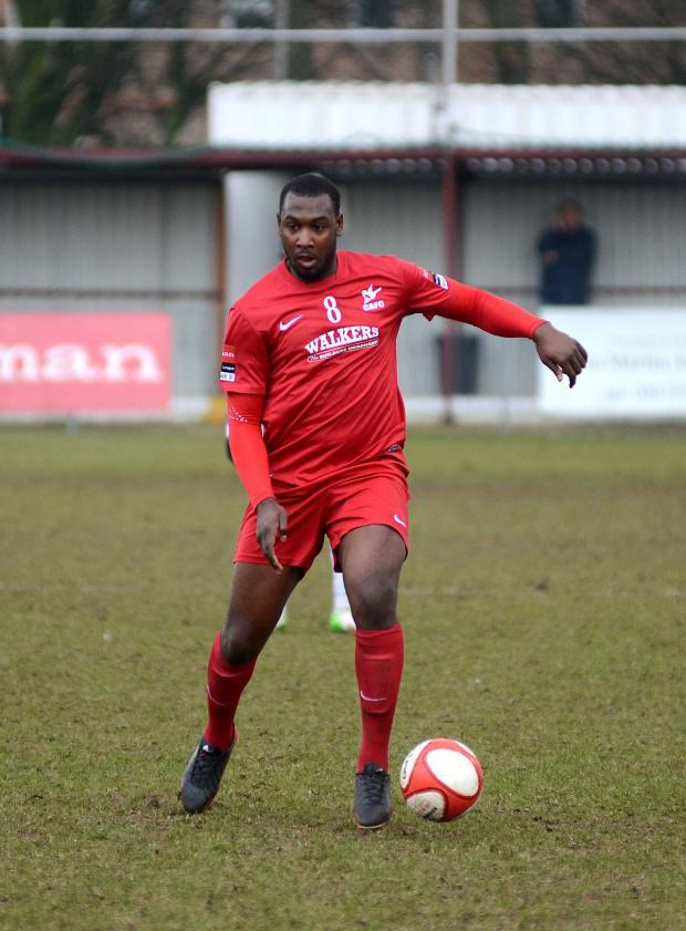 Wimbledon Guardian: Hakeem Adelakun playing for Carshalton Athletic