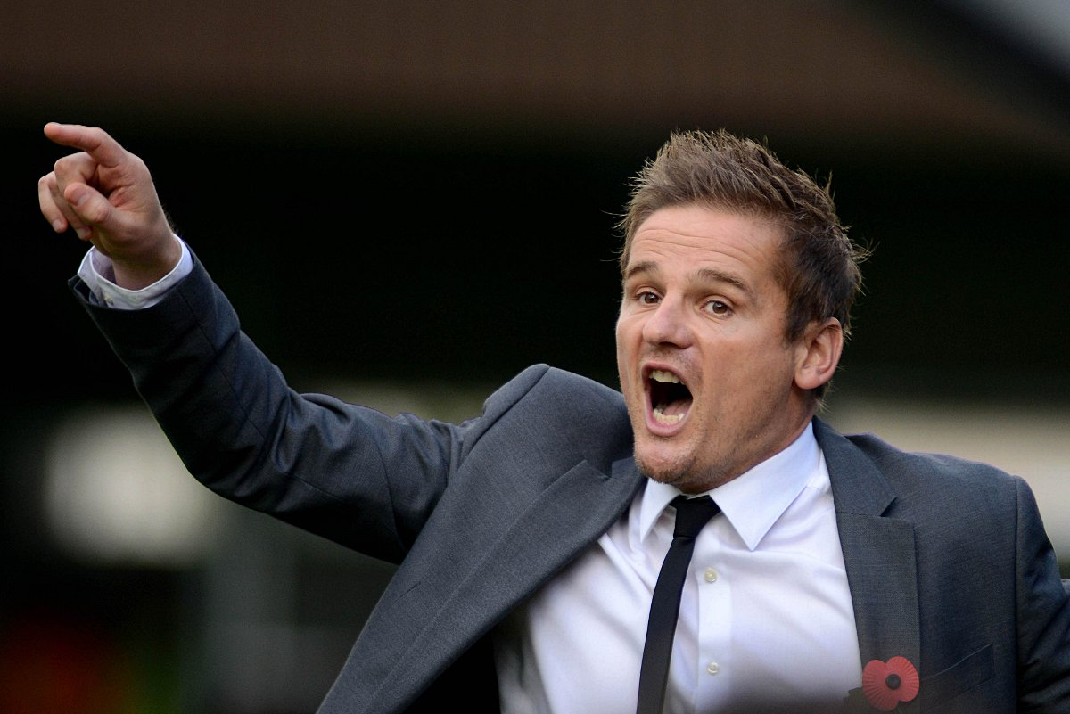Unhappy: Neal Ardley was saddened by his team's performance in the 3-0 defeat against Ro