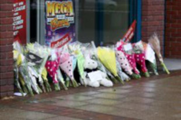 Flowers at Ladbrokes Morden at the time of the murder