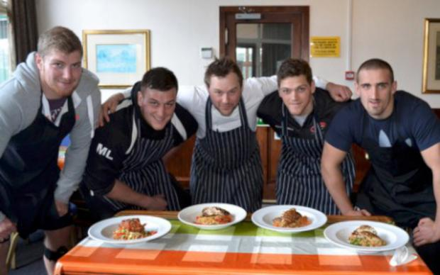 Grub's up: Ben West, Mitch Lees, James Tincknell and Carl Kirwan flank chef Anthony Shaw