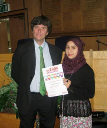 Councillor Nick Draper presents a certificate to a Six Book Challenge winner at last year's ceremony