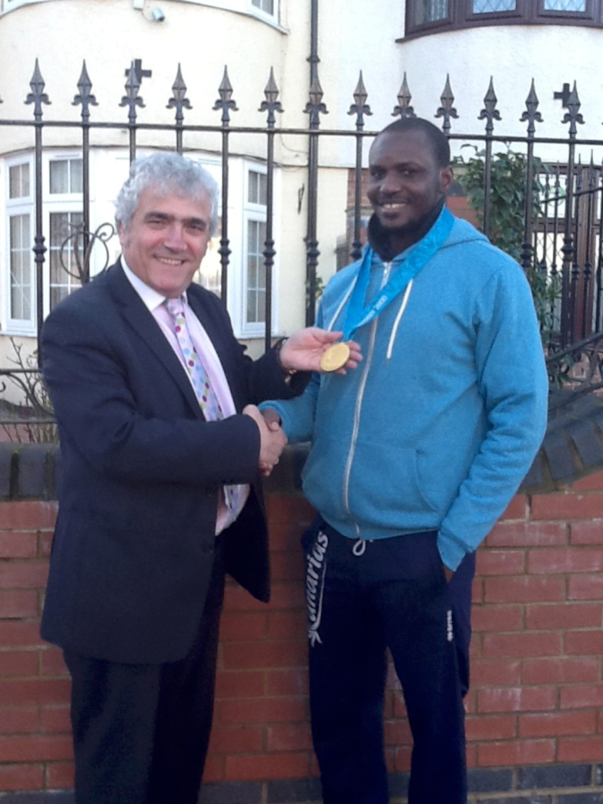 Olympian turned councillor Fidelis Gadzama with Merton Council leader Stephen Alambritis