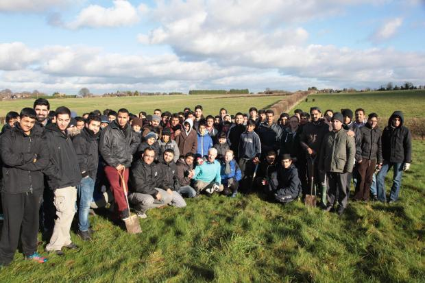 Community effort: The young people gather at the farm to begin work