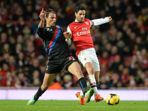 Wimbledon Guardian: Marouane Chamakh battles it out with Mikel Arteta yesterday. PICTURES BY KEITH GILLARD.