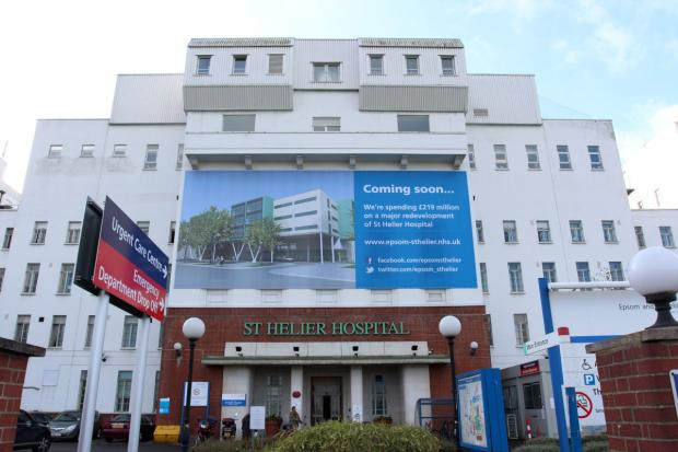 A banner still adorns St Helier Hospital saying the redevelopment is 'coming soon'
