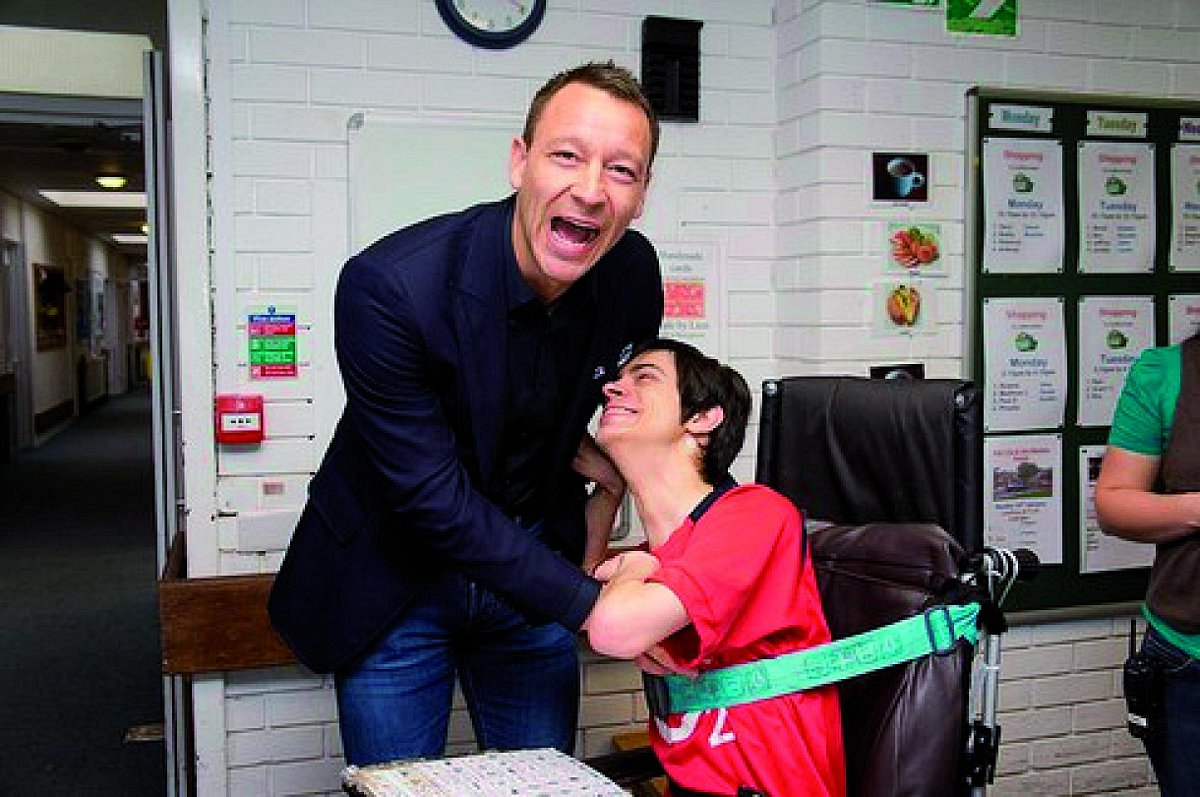 PICTURES: Arsenal fan teases John Terry during charity visit