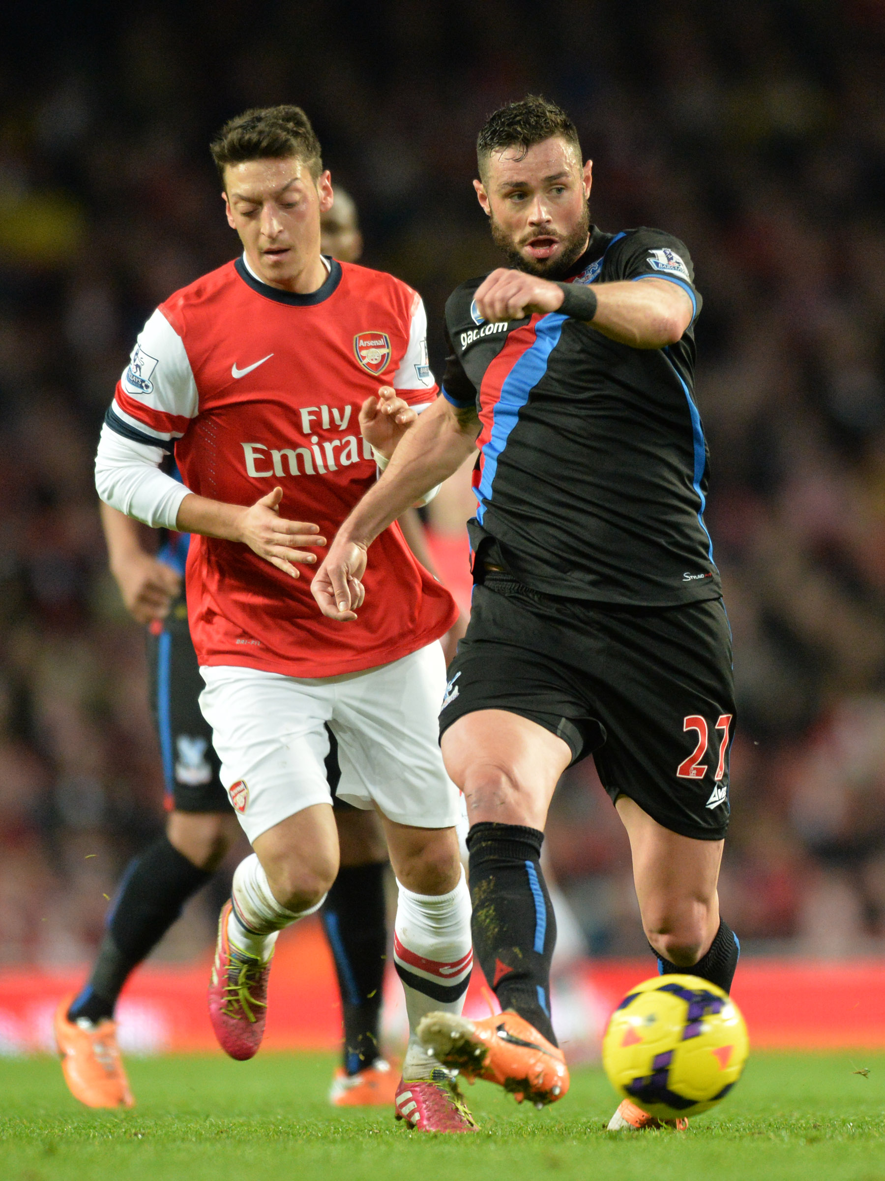 Wimbledon Guardian: The Eagles defender gets the better of German star Mesut Ozil at the Emirates. PICTURE BY KEITH GILLARD.