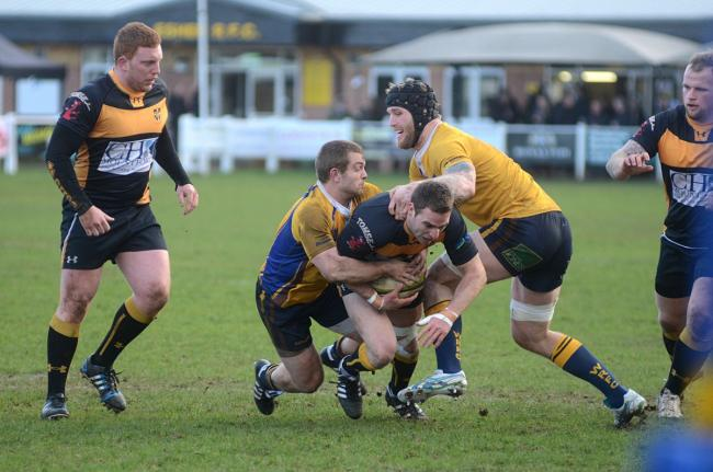 Squeezed: Patrick O'Grady is halted by the Worthing defence as hooker Neil Sweeney moves in to support during Esher's 36-19 win on Saturday 	Deadlinepix SP82768