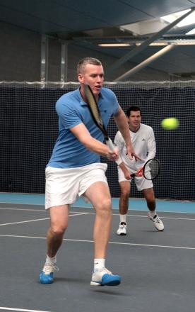 Long haul: Richmond Tennis Club coach Michael Jones joined Tim Henman, right, on court at the National Tennis Centre in Roehampton to raise money for charity 	SP82668