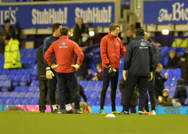 Wimbledon Guardian: Palace players warm up before the game was cancelled