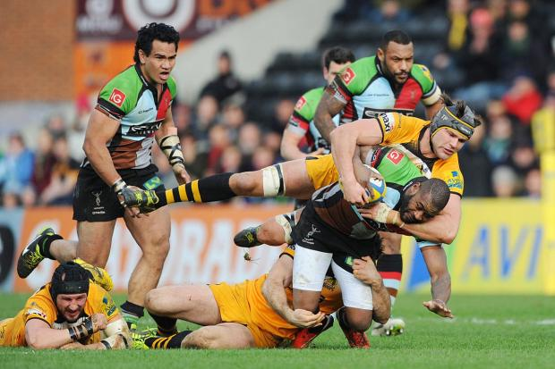 Battle hardened: Quins winger Ugo Monye is halted by Wasps loc