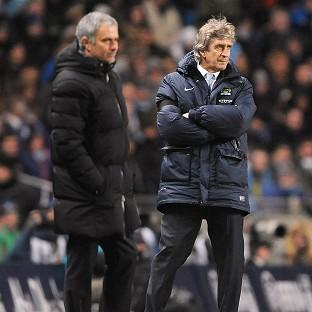 Jose Mourinho, left, and Manuel Pellegrini face one another i