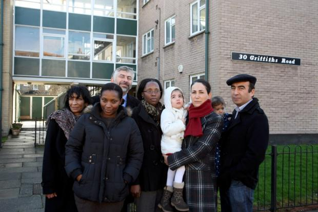 Evicted: Residents in Griffiths Road, Wimbledon, with Councillor Andrew Judge