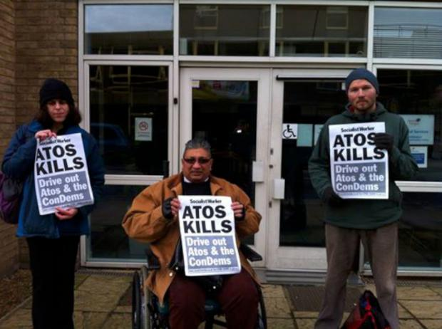The small protest saw Atos close its office and riot police called out