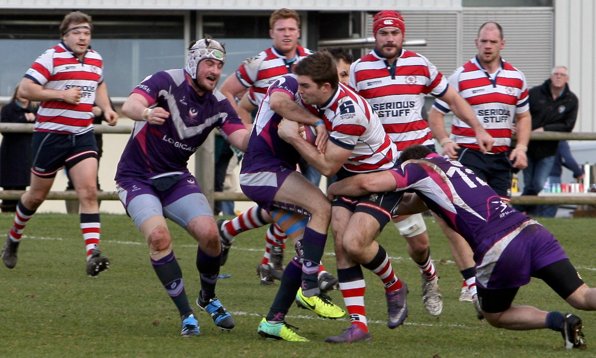 Hanging on: Rosslyn Park's Henry Staff under pressure in the narrow win at Loughborough Students      Picture: David Whittam