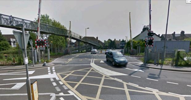 Google images: The level crossing in West Barnes Lane