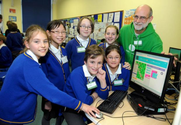 Year six children from Merton Park primary school at code club