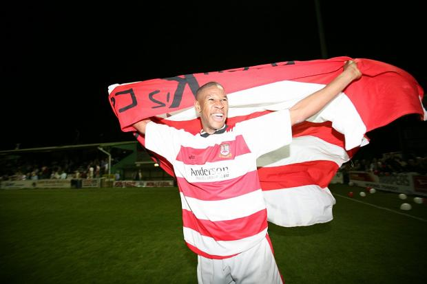 Past glories: Striker Tony Reid celebrates Kingstonian's last Surrey Senior Cup triumph in 2006