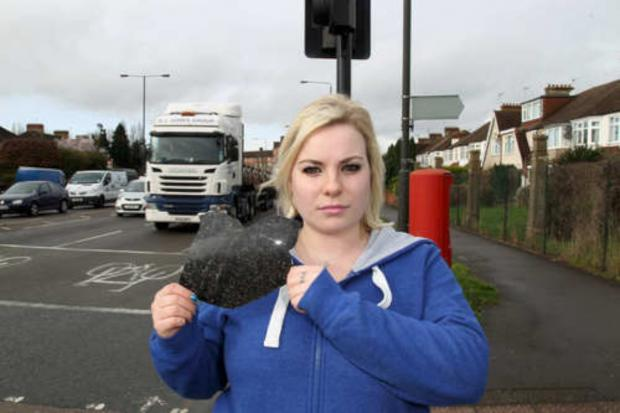 Sophie Beattie holds a bit of her car she found after the collision in Bushey Road