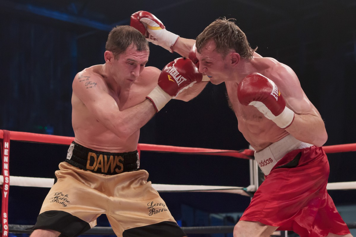 Keeping busy: Lenny Daws takes on, and beats, journeyman Arek Malek over eight rounds on Saturday night              All pictures: Lenny Daws