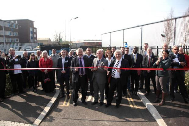 Councillor Stephen Alambritis, Jim Trotter, BID chairman and Councillor Andrew Judge cutting the ribbon.
