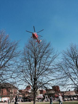 The air ambulance helicopter lands at the scene in Mitcham.