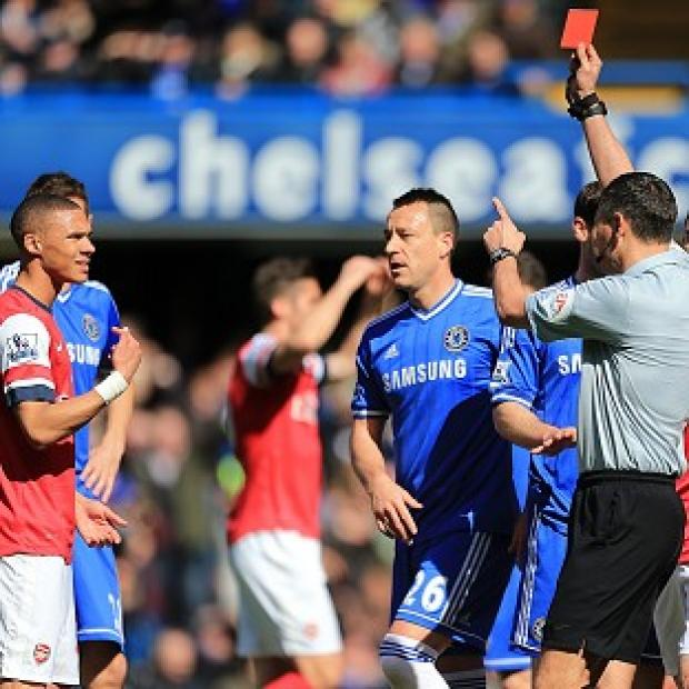 Wimbledon Guardian: Andre Marriner, right, mistakenly sent off Kieran Gibbs, left, during Arsenal's 6-0 defeat