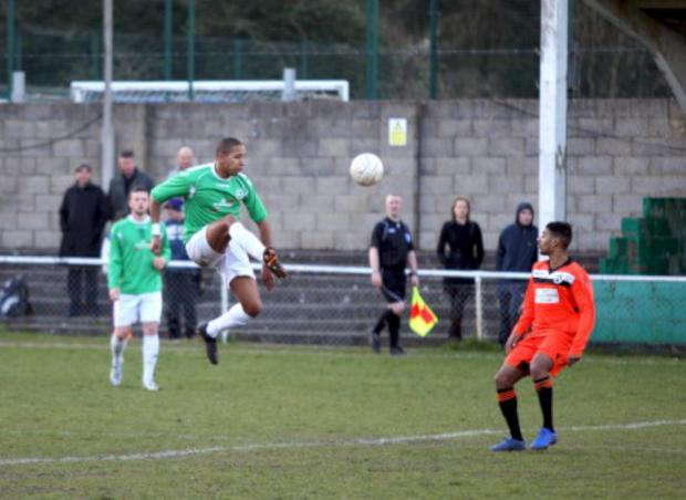 High-fliers: Louis Hollingworth in action for the Leafe in the 7-2 win over Fisher at the weekend