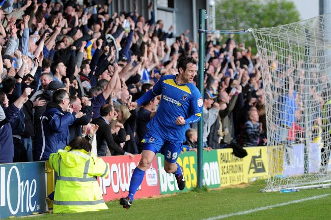 Final day drama: Alan Bennett celebrates the opening goal in Dons vital, final day win over Fleetwood Town               SP73108