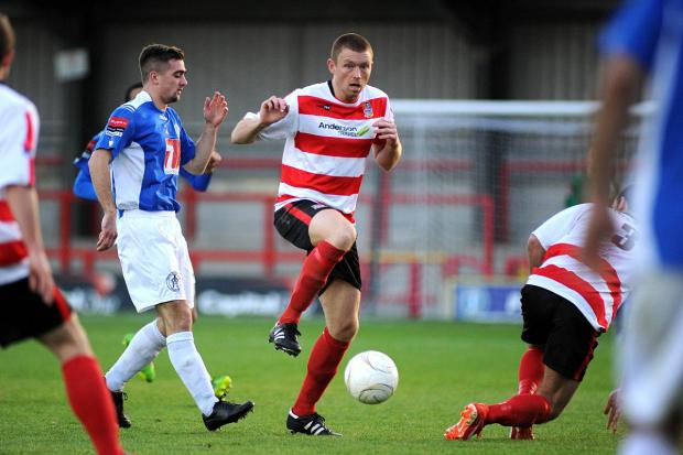 Keeping things tight: Kingstonian captain Sam Page is more keen on keeping goals out of his own net rather than scoring