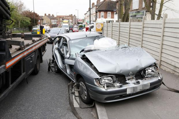 Wimbledon Guardian: The car after the collision in Martin Way, Morden