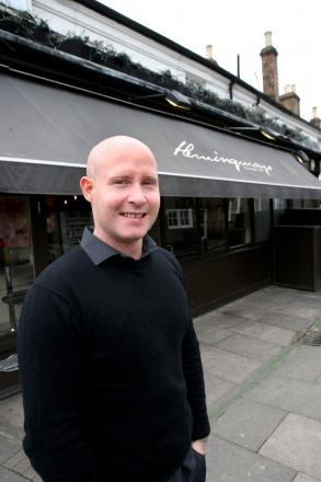 Mike Mitchell pictured outside his workplace Hemingways bar in Wimbledon