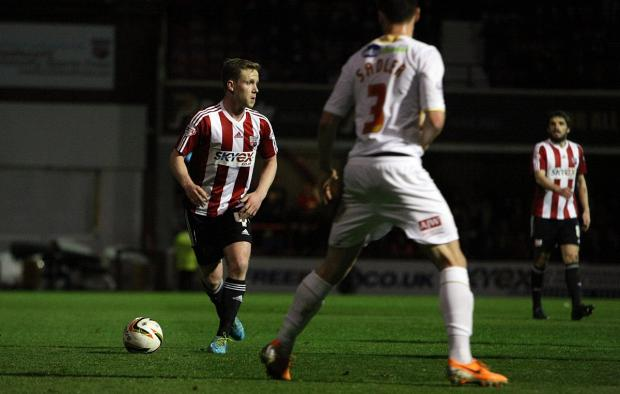 Off: Brentford midfielder Adam Forshaw saw red early in the second half after picking up a second yellow card