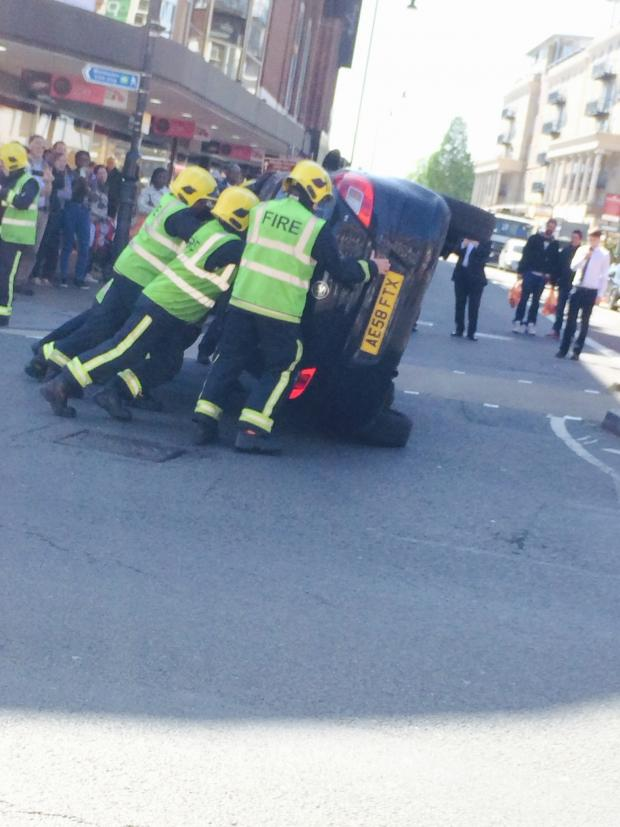 Wimbledon Guardian: Car flipped on its side in Wimbledon town centre