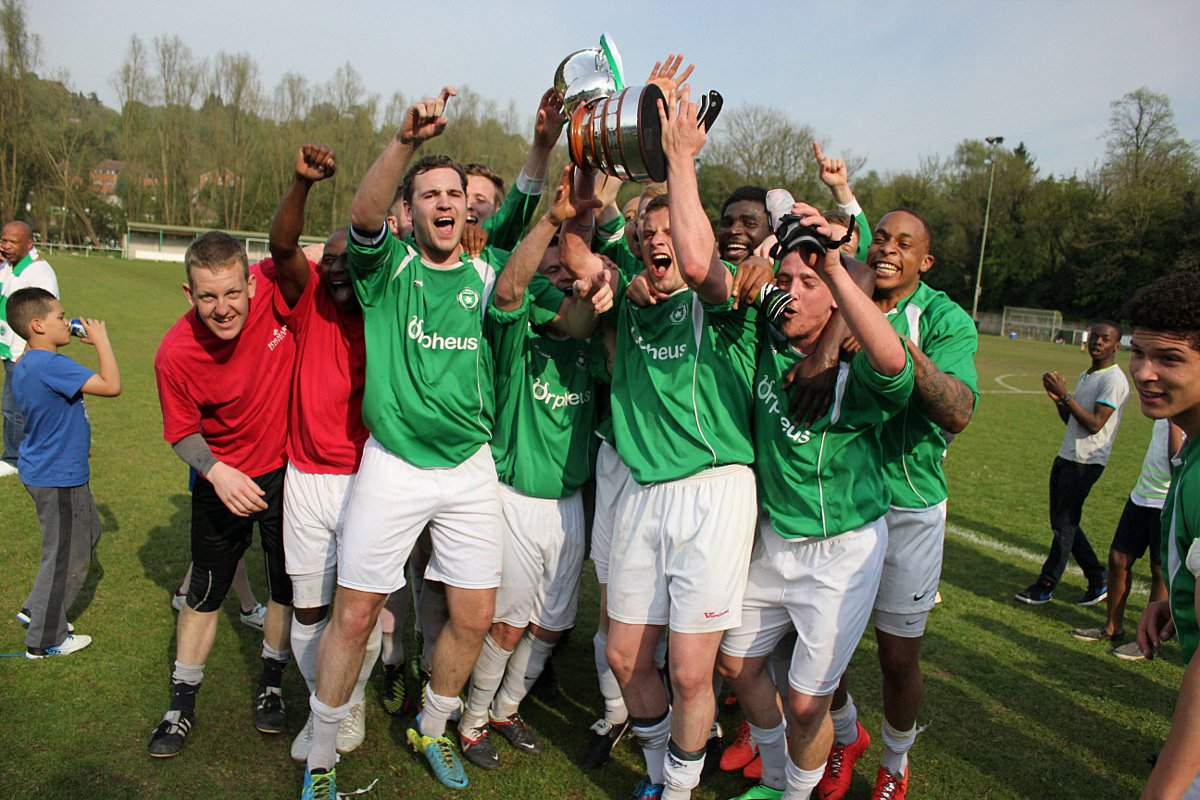 Make the most of it: The Whyteleafe players get the promotion party started                       Picture: Chris Layton