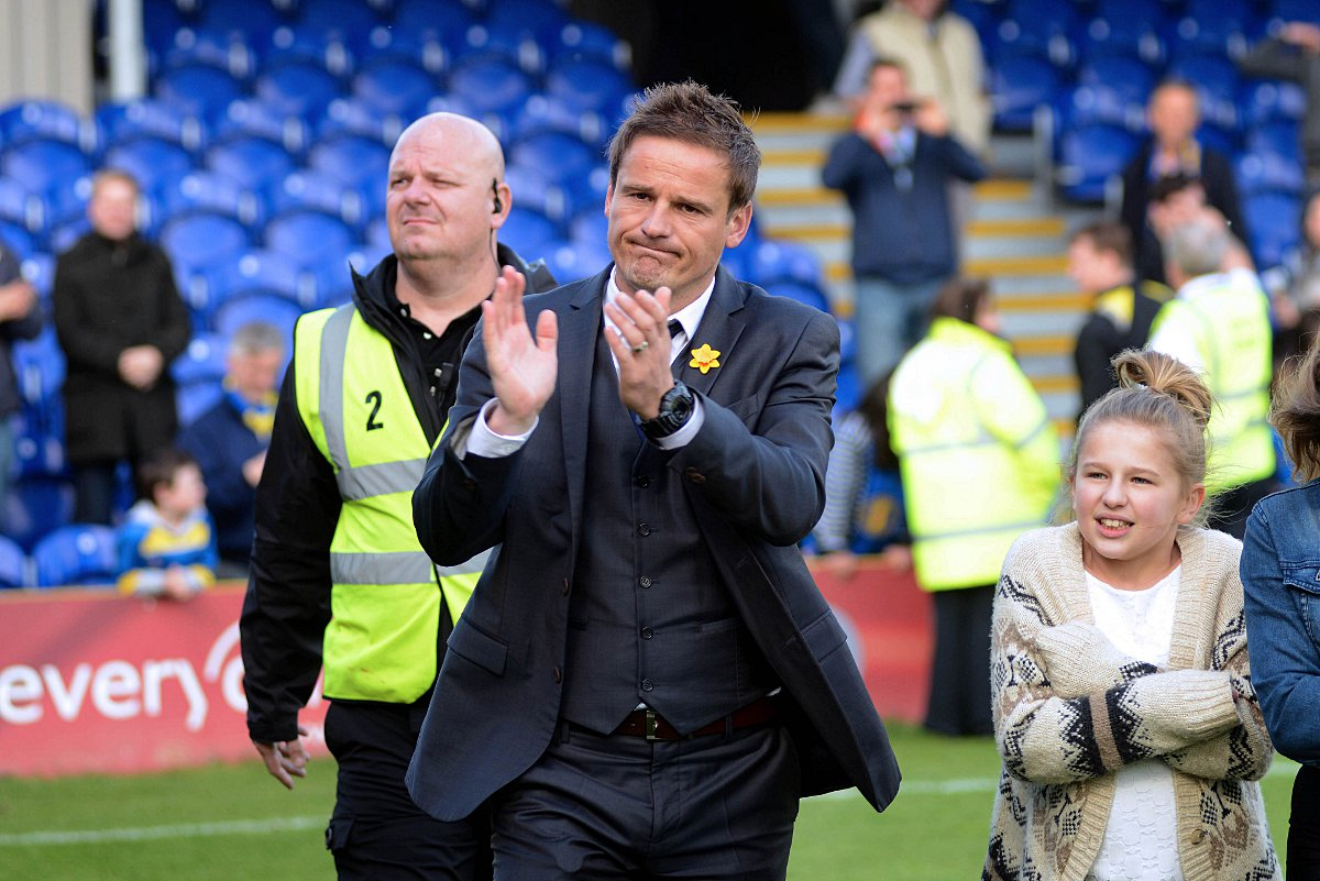 Glum: Neal Ardley salutes the cr
