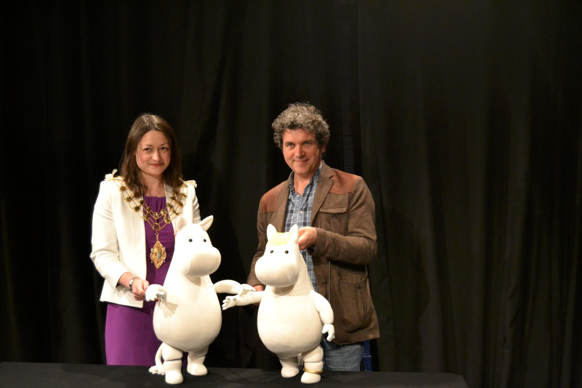 The mayor of Merton with Polka Theatre artistic director Peter Glanville and two Moomins
