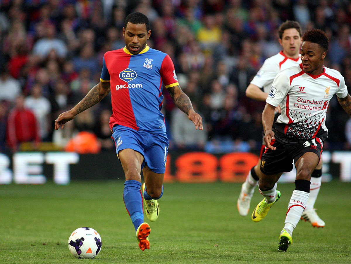 Wimbledon Guardian: Jason Puncheon tries to get away from Raheem Sterling