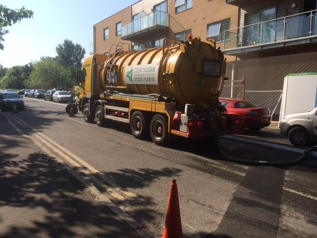 Truck pumping sewage from Windmill Road in Mitcham
